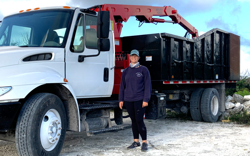 Abby Phillpot, a senior studying environmental science, drove a grapple truck used to haul away debris. A Samaritan's Purse contractor hired her to operate heavy machinery over her spring and summer breaks at home in the Bahamas.