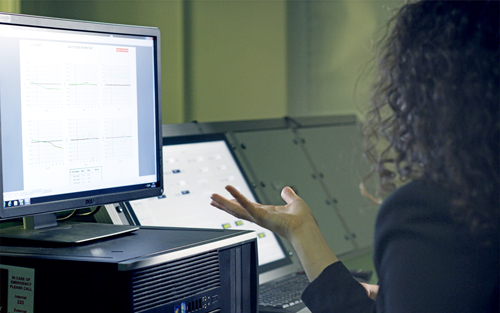 A woman works at her computer. The computer science degree prepares graduates for work in a growing field.