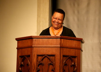 Gloria Burgess smiles during a presentation for the MacArthur School of Leadership.