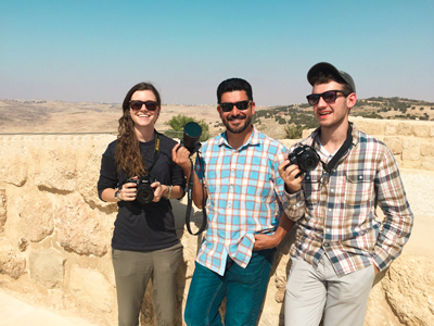 "Jacklyn Streng, journalism professor Dr. J. Israel Balderas and Tim DeMoss pose for a photo while on location filming their award-winning documentary, ""Four Families in Mafraq."" They produced the documentary, which tells the stories of four Syrian refugee families living in Jordan, in conjunction with the intercultural studies department."