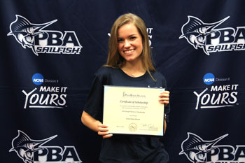 Farish Scholar Grace Barrett poses with her scholarship certificate at a National Signing Day-style ceremony at Alexander W. Dreyfoos School of the Arts last week. PBA awarded Barrett a four-year full scholarship.