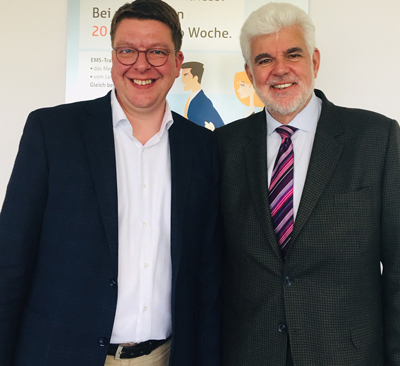 German Franchise Association Chief Managing Director Torben Brodersen and Titus Center for Franchising Dr. John Hayes pose for a photo. The German Franchise Association made a $4,000 gift to create an international franchising fellowship for a student.