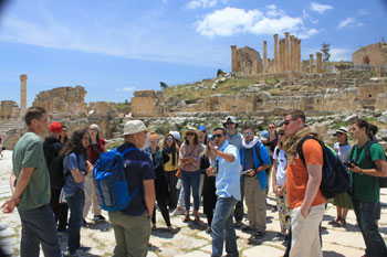 Students listen to their guide explain their surroundings at Jerash in Jordan. It was one of many sites they visited during a two-week tour of the Holy Land.
