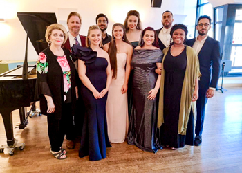 Voice teachers Marilyn Mims, Dr. Lloyd Mims and their students, daughter Virginia Mims, Aarun Kassam, Sydney Carbo, Lauren Graber, Sarah Rogers, Daland Jones, Zaryah Gourgel, and Arvindan Thekkadath pose for a photo at the Fondation Bell'Arte's Paris International Summer Sessions.