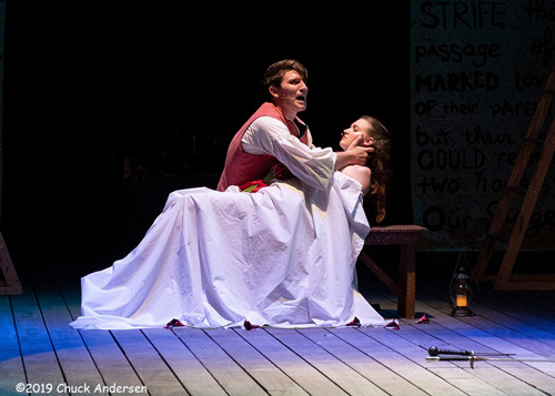 "Romeo, played by John Campagnuolo, mourns over Juliet, played by Lindsey O'Neill, during ""Romeo and Juliet,"" the Shakespeare by the Sea production presented by the Palm Beach Shakespeare Festival. Photo by Chuck Andersen"