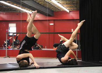 Students do core exercises that are a combination of dance and Pilates in Associate Professor of Theatre Allen McCoy's stage combat class.