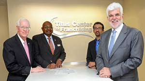 University President William M. B. Fleming, Jr., American Global Consulting President Dr. Alsadig Khalafalla, AGC Director of International Training Mohamed Faiz Shaban and Titus Center for Franchising Director Dr. John P. Hayes, pose for a photo in the Titus Center for Franchising following the signing of an agreement for Hayes to teach franchising seminars in Bahrain. Khalafalla and Shaban visited PBA on Aug. 20 and 21, 2019.