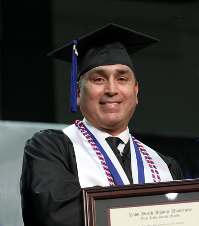 Adam Pina is the Outstanding Graduate from the Catherine T. MacArthur School of Leadership. Pina was seriously injured in a career-ending accident shortly after starting his degree. It didn't stop him from finishing.