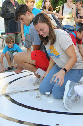 Students Cindy Hugel and Mason Boudreaux race their roaches in the Rinker parking lot during the 37th Annual Great American Bug Race on Wednesday, November 6, 2019.