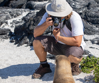 Dr. Tom Chesnes photographs a sea lion in the Galápagos Islands. The island is so protected that the animals let human visitors get very close. Photo by Dr. Robert Lloyd