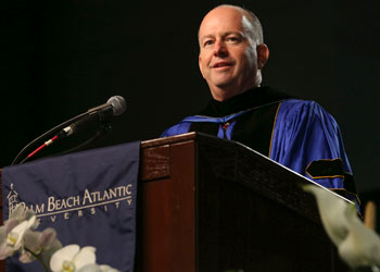 Former U.S. Senator George LeMieux delivers the commencement address to nearly 600 graduates at the Palm Beach County Convention Center during the May graduation ceremony.