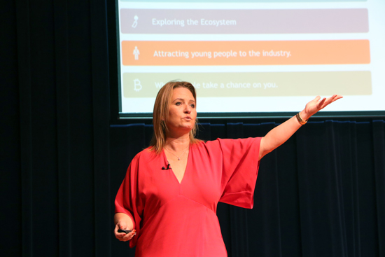Serial entrepreneur Jennifer Kushell speaks to an auditorium full of Titus Center for Franchising students, faculty and advisory board members about attracting young people to the franchising industry.