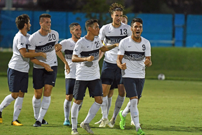 The Sailfish men's soccer team celebrates at a game last season.