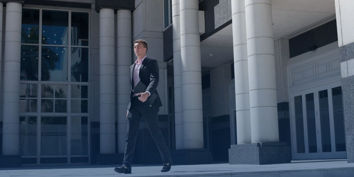 Business student walking downtown west palm beach