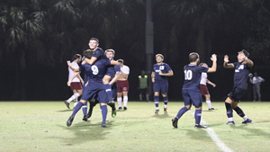 The Sailfish men's soccer team celebrates at a game. The Sailfish are the No. 2 seed of Super Region 2 in the NCAA tournament.