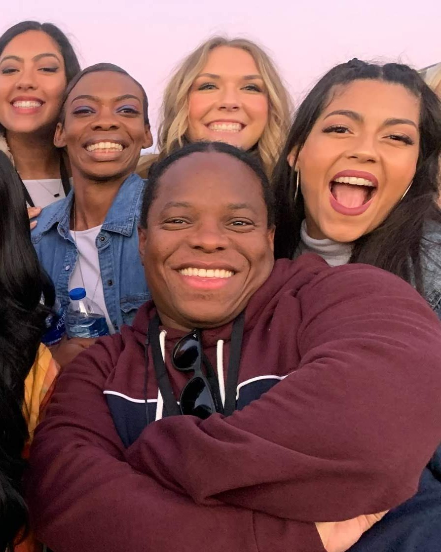 Brianna Figueroa, Adrienne Khouri, Nora Barker and Ruth Ann Batista-Morales pose for a photo with their hip-hop instructor Larry Albright, who landed them an invitation to join the field cast at the Super Bowl halftime show.