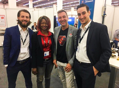 German Franchise Association fellow Paul Brockley, a senior studying marketing, poses for a photo with with Bodystreet co-founders Emma and Matthias Lehner and Glenn Curth who sells franchises for Nordsee, a German fast food chain specializing in seafood.