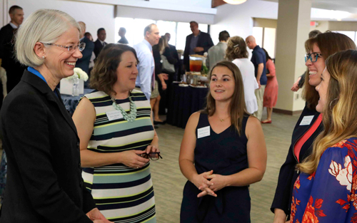 President-Elect Dr. Debra A. Schwinn greets Kara Wenger, director of residence life; Natalie Johnson, director of student activities, involvement & leadership; Kate Magro, assistant dean of students and Kristin Knudsen, associate director of student activities, involvement and leadership during a reception on Thursday, Jan. 16, 2020, following the announcement of her hiring.