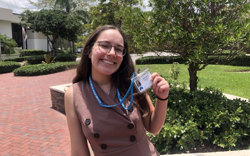 Maria Landron, a rising senior studying public relations, completed an internship with the Village of Royal Palm Beach to increase census participation. Here, she poses for a photo outside the Village Hall.