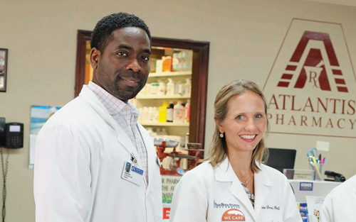 Drs. Damien Simmons and Erin Dorval made their own hand sanitizer at Atlantis Pharmacy.
