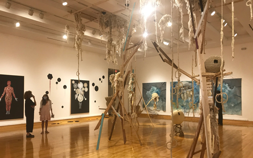 "Heather Couch, assistant professor of art, is exhibiting her work in the ""When We See Further"" show at the Wasmer Art Gallery at Florida Gulf Coast University."