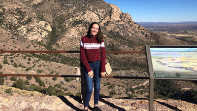 Maria Landron, a junior studying public relations, poses for a photo along Arizona's border with Mexico on a fact-finding trip for her public relations campaigns course. She and her teammates developed a campaign to tell the stories of cattle ranchers who are affected by illegal immigration at the border.