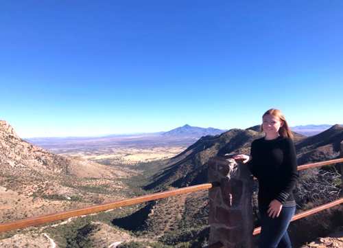 Madison Stoneburner, a junior studying public relations, poses for a photo at Arizona's border with Mexico on a fact-finding trip for her public relations capstone project. She and her teammates in Dr. Wes Jamison's public relations campaigns course are educating college students with stories from cattle ranchers affected by illegal immigration.