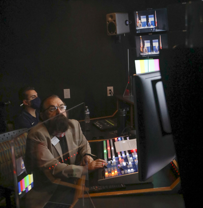 Professor Don Piper, chair of the Applied Digital Media Department, monitors the interview in the studio control room.