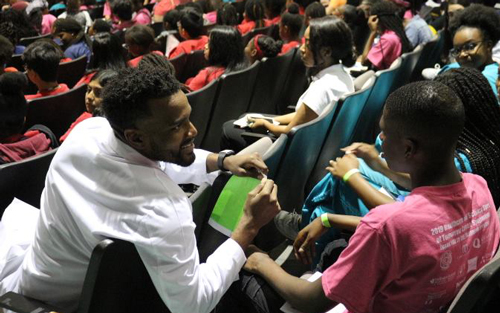 Emmanuel McNeely, a 2012 Palm Beach Atlantic graduate and medical student, speaks to young people about pursuing careers in medicine. He started the Dr. McNeely Dream (M.D.) Project with his wife, Sa'Rah McNeely, to increase minority representation in medicine.