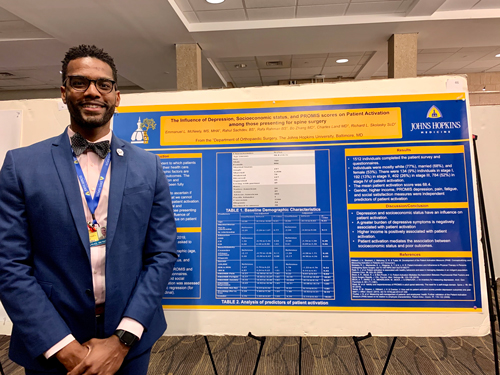 Emmanuel McNeely presents his research poster.