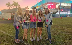 Jessica Kieffer, Kelli Urbanek, Lili Hurst, Nora Barker and Venorah Sieling pose for a photo at Hard Rock Stadium. They were among hip-hop instructor Larry Albright's students who joined the halftime show field cast.