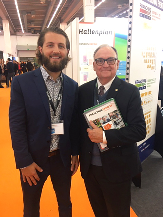 German Franchising Association fellow Paul Brockley, a senior studying marketing, poses for a photo with Titus Center Advisory Board Member Bill Edwards, CEO of Edwards Global Services, at Franchise Expo19 in Frankfurt, Germany.