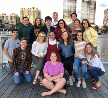 The 2020-21 Steering Committee poses for a photo at sunrise along the West Palm Beach waterfront in February. Front: Libby Aaron Row 1: Hunter Forster, Samantha Wilber, Macy Beard, Emma Reule, Rachel Smalley, Taryn Browning; Row 2/Back: Jonathan Hernandez (kneeling), Christopher Morgret, Hannah McCanse, Liam Devine, Nathan Slager, Sophie Gonzalez, Nate Olver, Jessica Tarno, Victoria Holmes