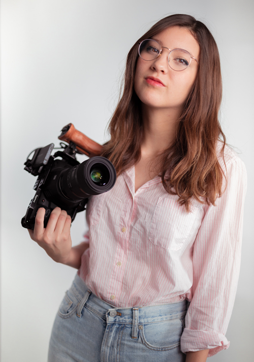Daniela Stanton, a 2019 cinema arts alumna, poses for a photo with her camera. Crunchi, a toxin-free cosmetics and skin care e-commerce company, hired her as a videographer/video editor in May.