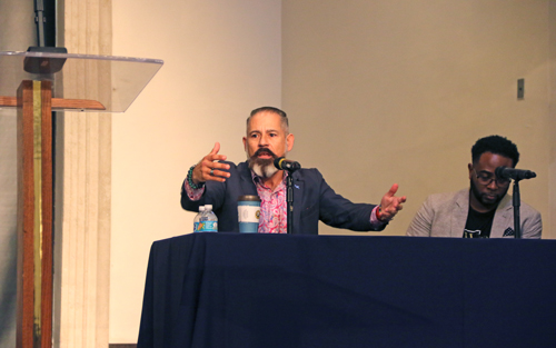 Dr. Oscar García-Johnson makes a point during the panel discussion in the DeSantis Family Chapel as part of the Jess Moody Faith and Culture Forum on Thursday, Feb. 13, 2020. Author and national speaker Jemar Tisby listens to his right.