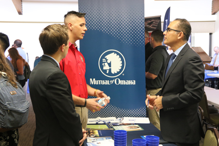 A student talks with representatives from Mutual of Omaha during an internship expo in September.