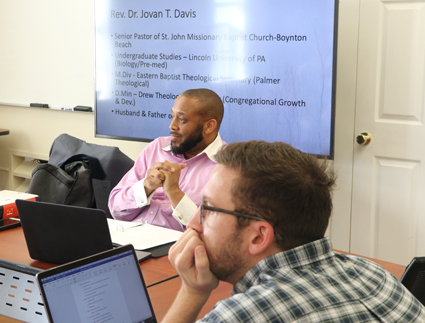 Rev. Dr. Javon T. Davis and Master of Arts in Christian Studies student Jake Graybill listen as another student shares about lament during a graduate School of Ministry intensive on the same subject. Davis taught about lament and proclamation.