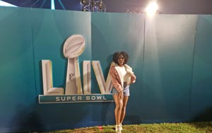 Dance alumna Victoria Smith poses for a photo at the Super Bowl. Larry Albright, a hip-hop instructor, extended an invitation to current and former students, to join the field cast for the halftime show.