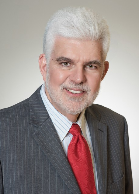 Dr. John P Hayes, Chairman of the Titus Franchising Center