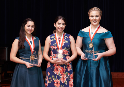 From left: Samantha Sosa, second place; Laura Santamaria-Mendez, third place, and Sarah Johnson, first place, show off their awards at the Schmidt Vocal Competition. Credit: LILA PHOTO