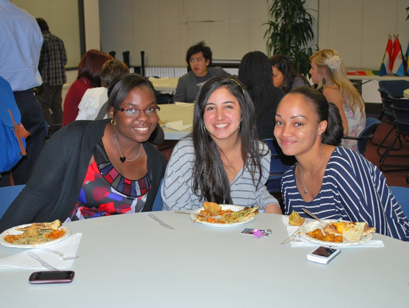 Students enjoy an international dinner as part of a club event at Palm Beach Atlantic University.