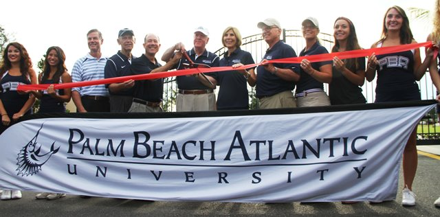 Palm Beach Atlantic University President William M.B. Fleming Jr. cuts the ribbon the 79-acre Marshall and Vera Lea Rinker Athletic Campus in September 2014.