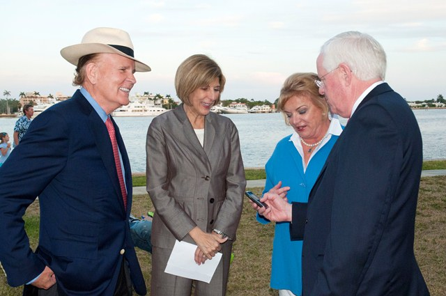 President William M. B. Fleming chats with Susan and Robert Wright, the founders of Light ItUp Blue, and Jeri Muoio, mayor of West Palm Beach.