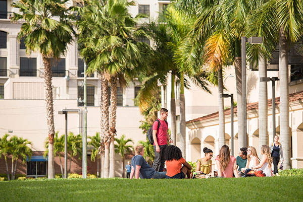 Palm Beach Atlantic students enjoy the beautiful campus outside of the Warren Library.